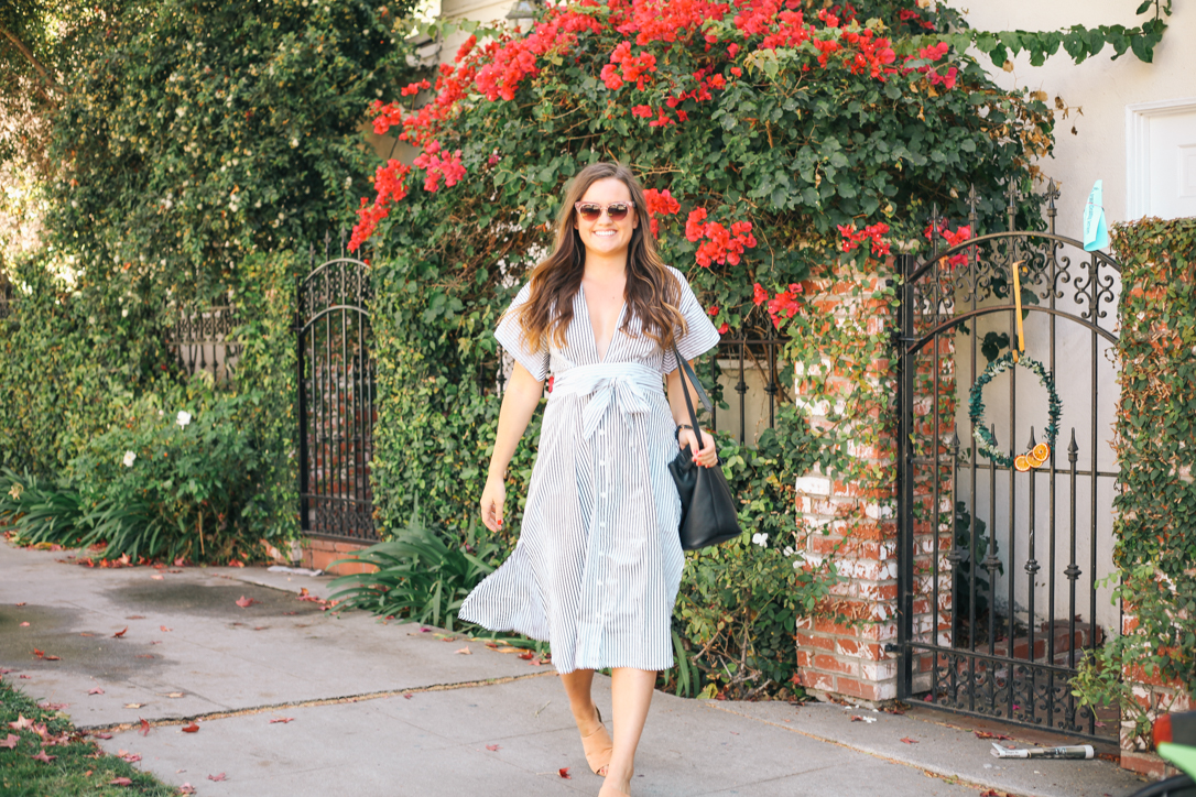 California Fall Bucket List in Faithfull The Brand Cove Stripe Mustang Midi Dress, DSW Kelly and Katie Camel Mules, Leatherology Black Bucket Crossbody and Pink Anthropologie Sunglasses in Santa Monica, CA. Rachel Broas of Simply Poised, simplypoisedfashion.com, @rachellaurenlucy